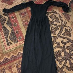 a black jumpsuit with a ruffled-like top half